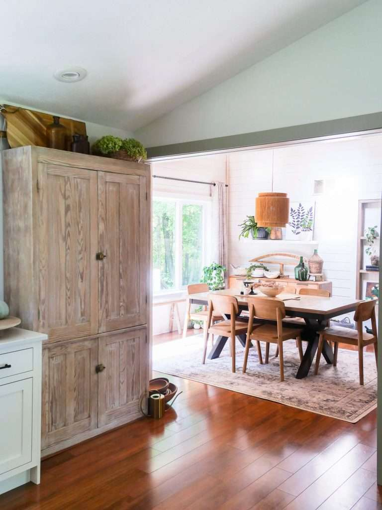 Dining room overview with a vintage cabinet.