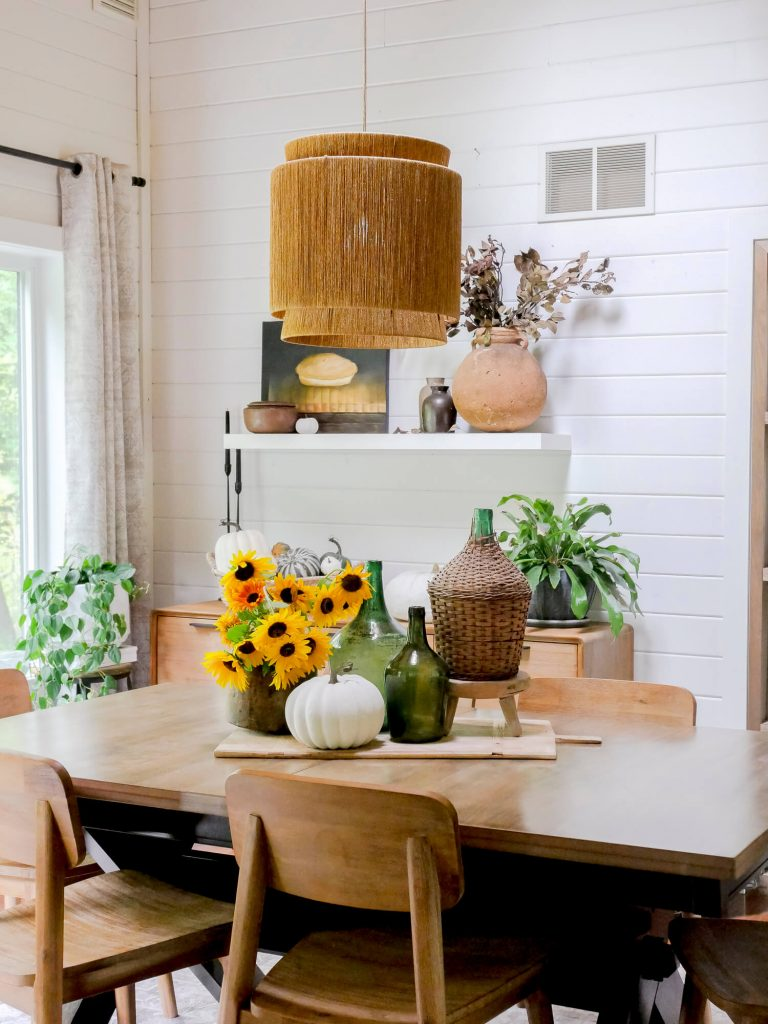 Rustic farmhouse centerpieces in a dining room.