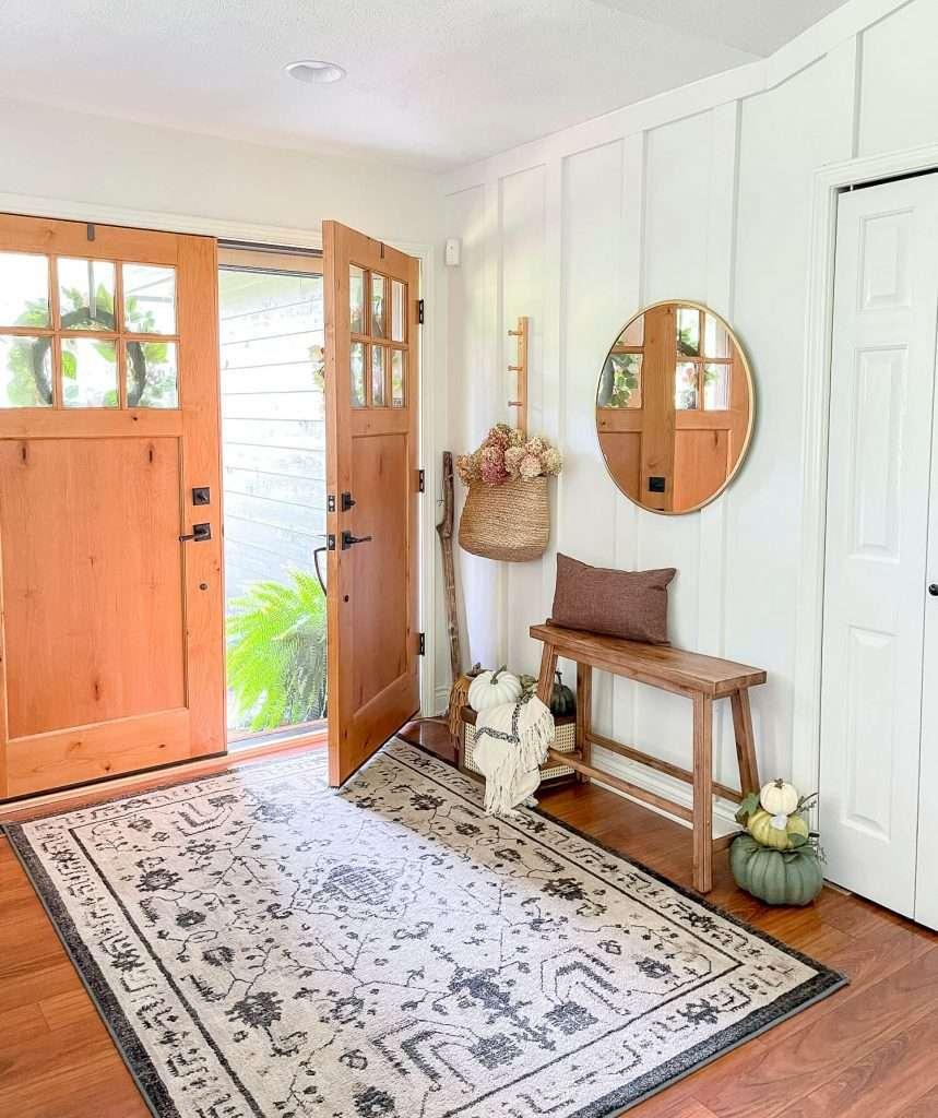 Rustic farmhouse entryway with an open door.