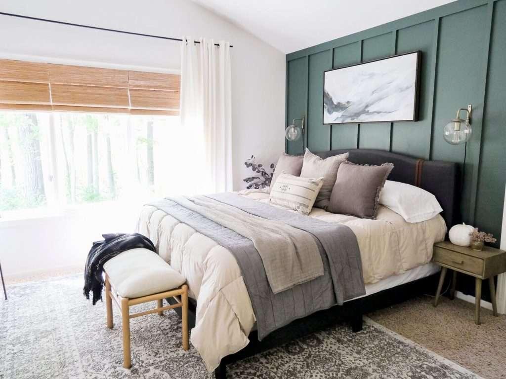 Green wall in a vintage modern bedroom.
