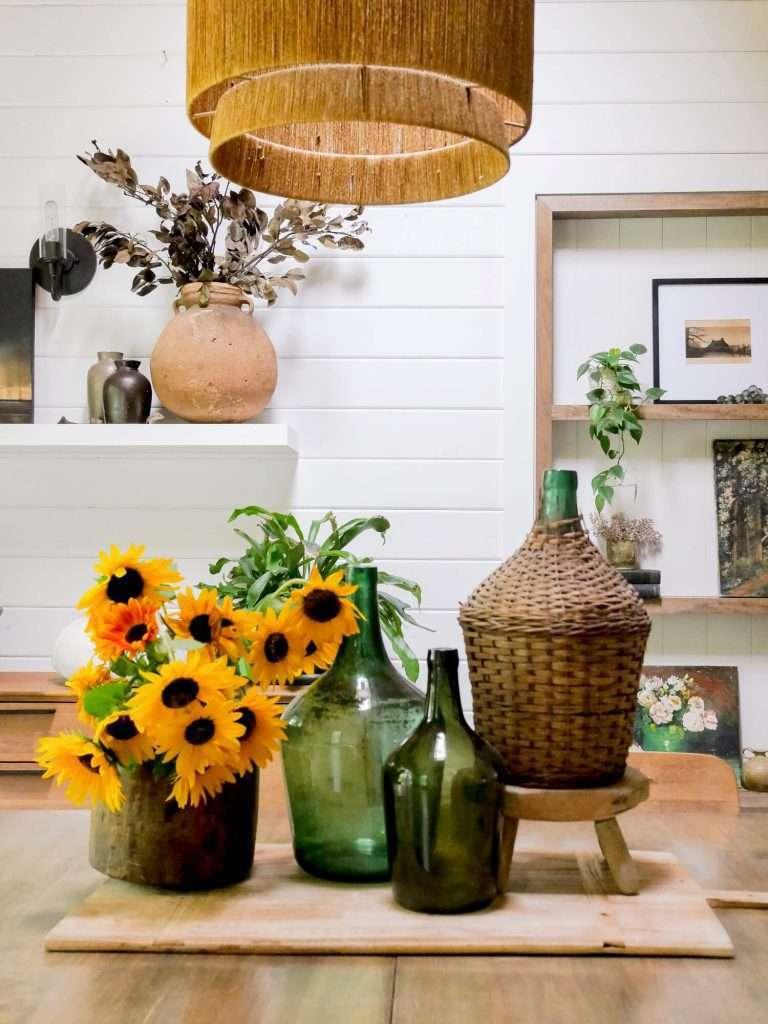 Adding sunflowers to a centerpiece.