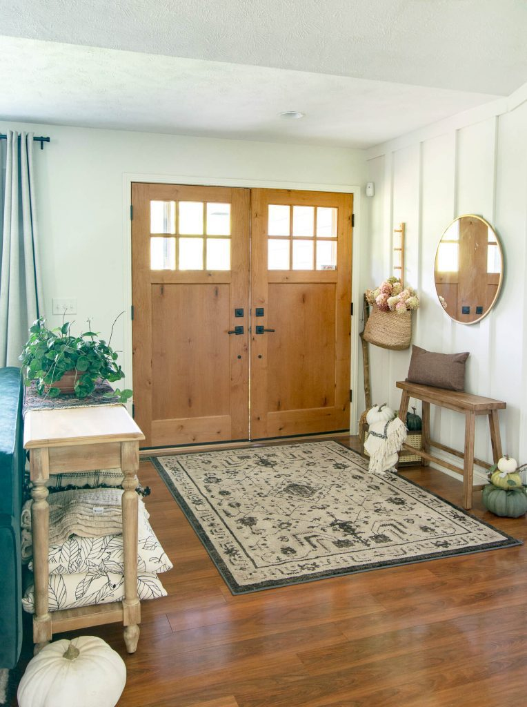 Fall entryway styled with rustic farmhouse decor.