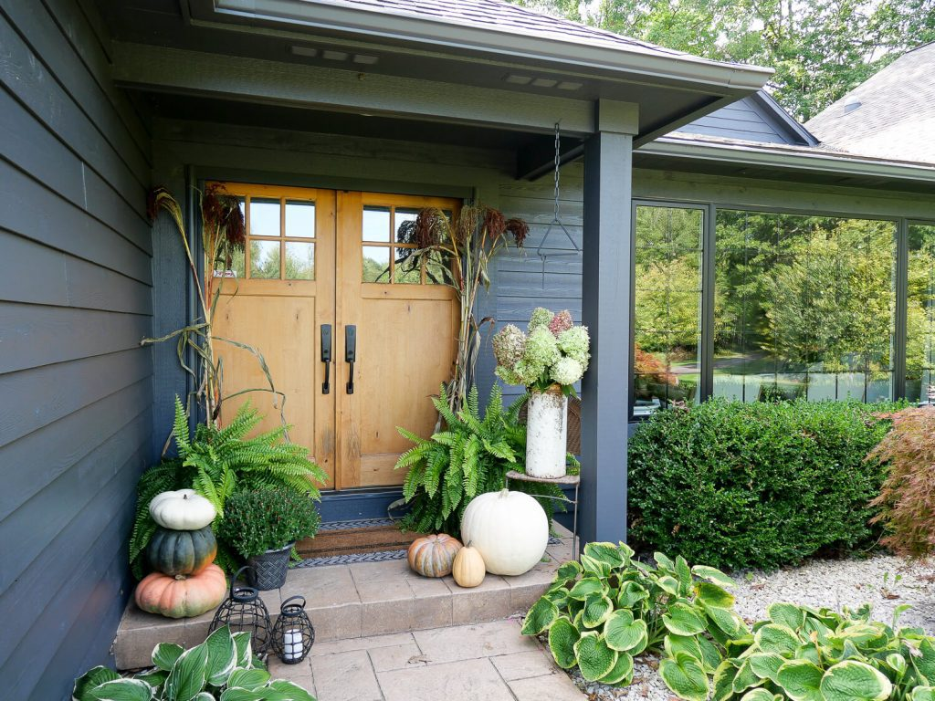 Home exterior decorated for fall.