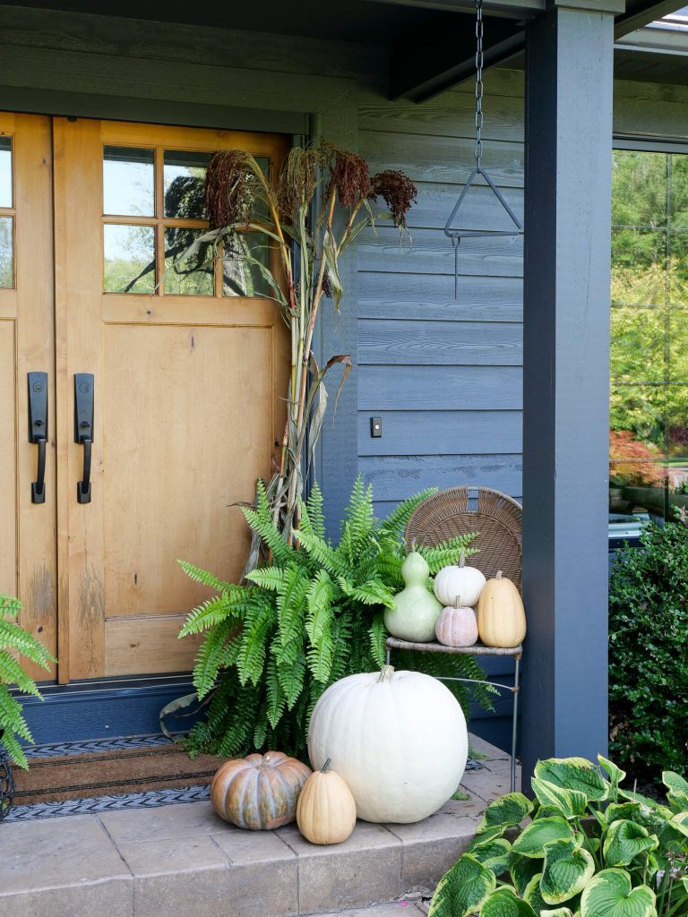 Pumpkins by a front door.