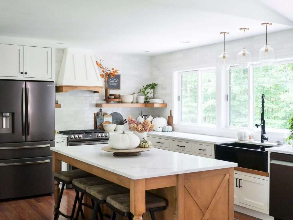 Full view of a farmhouse style kitchen with island.