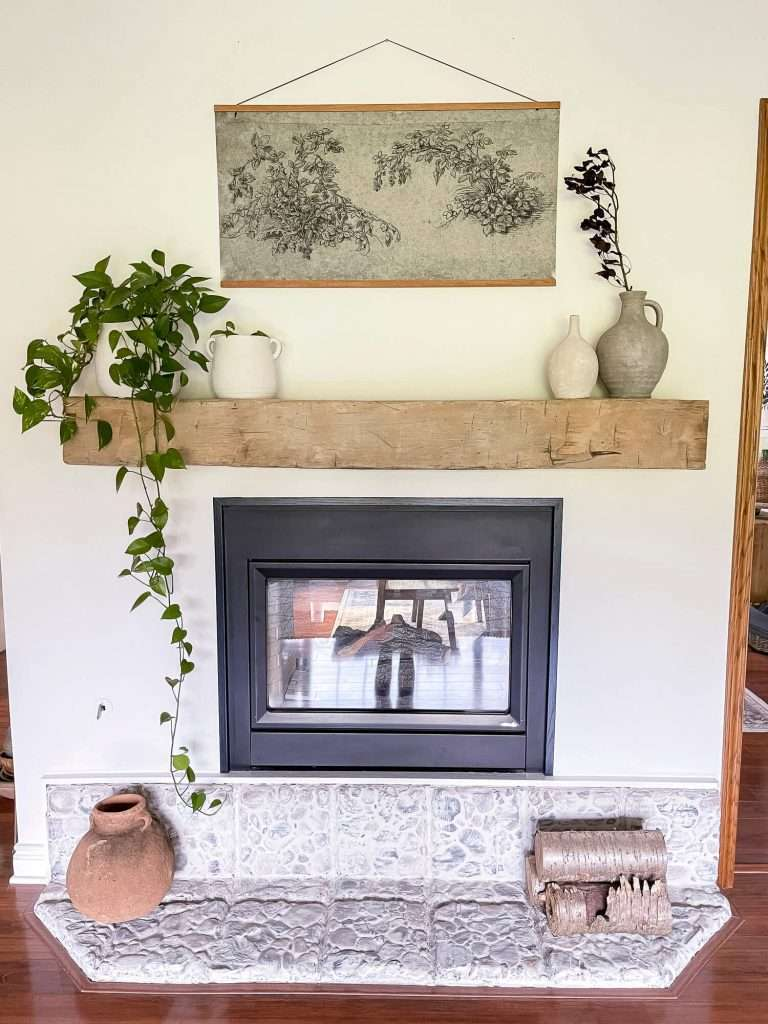 Fall mantel with neutral artwork.