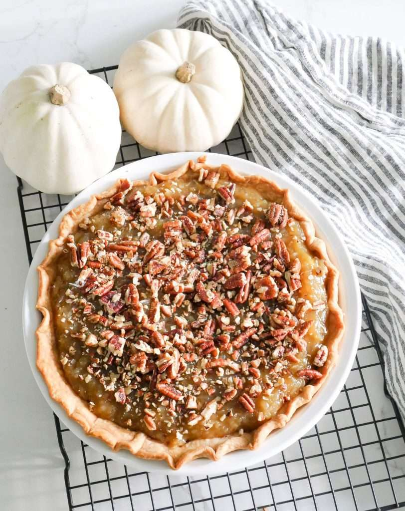 Fall pie with pumpkins and a kitchen towel.