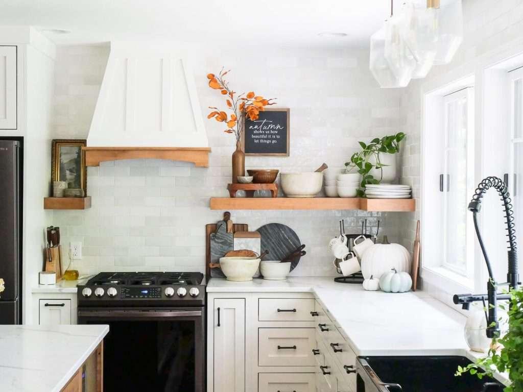 View of kitchen backsplash and open shelves.