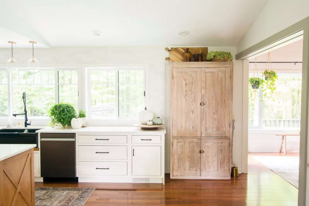 Kitchen pantry with a vintage modern cabinet design