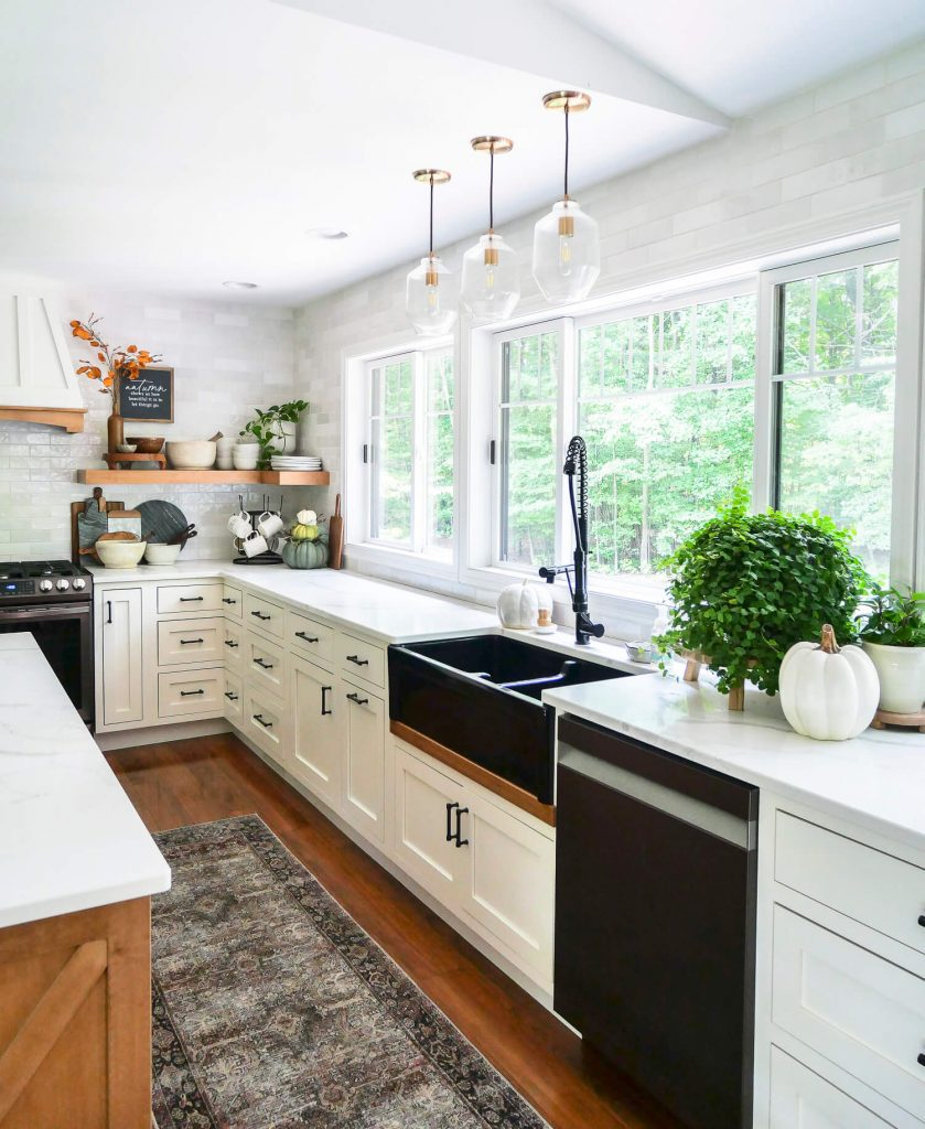 Black farmhouse kitchen sink with windows.