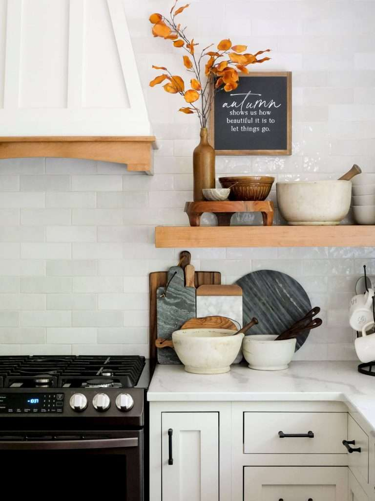 Kitchen shelf decorated for fall.