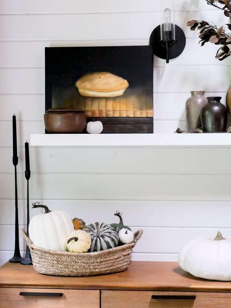 Basket of pumpkins on a buffet.